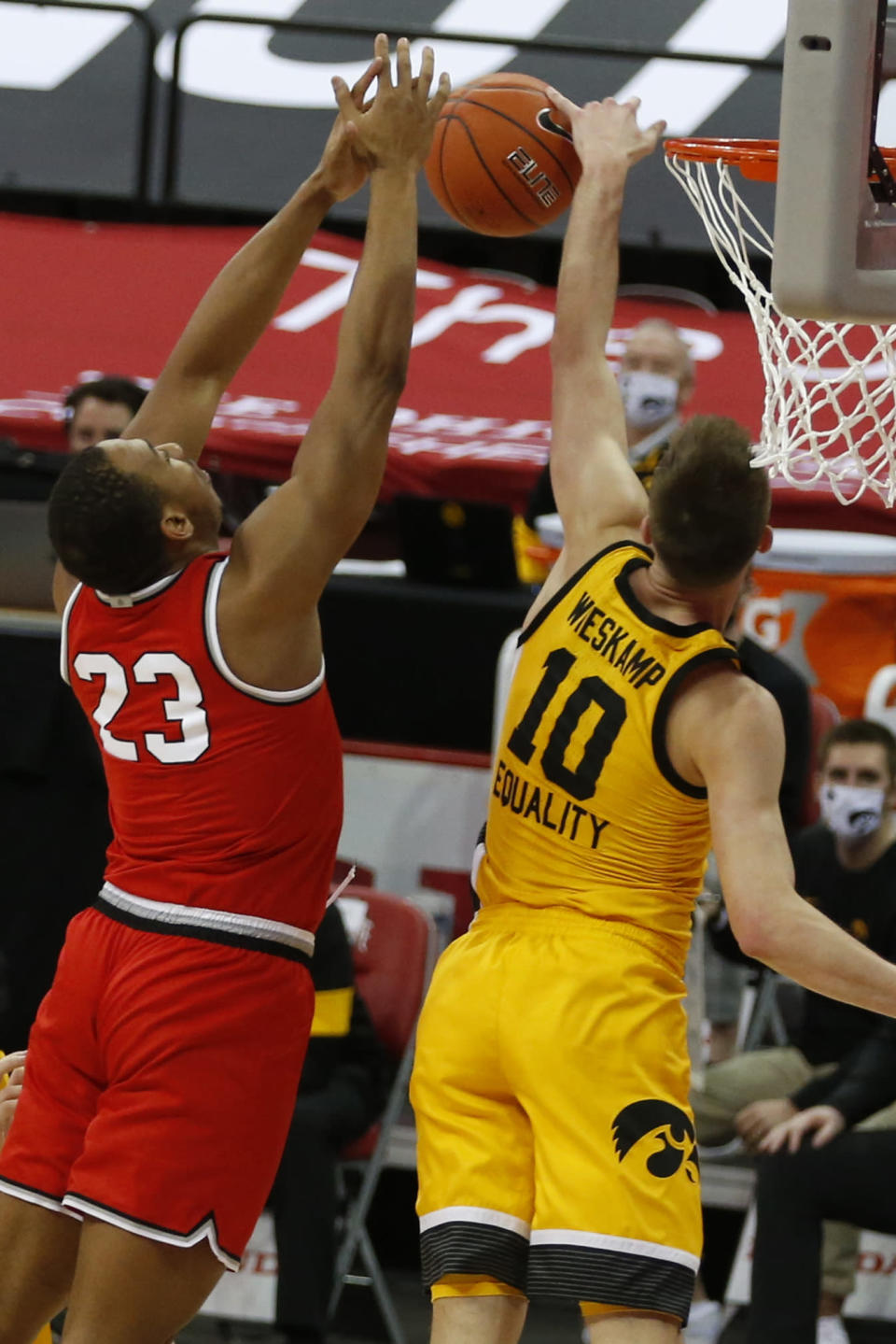 Iowa's Joe Wieskamp, right, blocks the shot of Ohio State's Zed Key during the first half of an NCAA college basketball game Sunday, Feb. 28, 2021, in Columbus, Ohio. (AP Photo/Jay LaPrete)