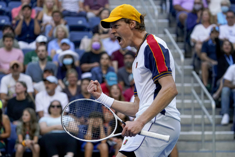 Jannik Sinner, of Italy, reacts after scoring a point against Gael Monfils, of France, during the third round of the US Open tennis championships, Saturday, Sept. 4, 2021, in New York. (AP Photo/Seth Wenig)