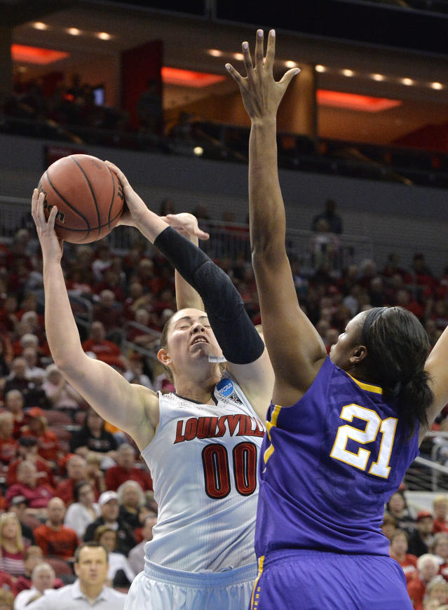 Louisville's Sara Hammond (00) is fouled from behind while attempting to shoot over the defense of LSU's Shanece McKinney (21) during the second half in a regional semifinal game at the NCAA women's college basketball tournament, Sunday, March 30, 2014, in Louisville, Ky. Louisville defeated LSU 73-47. (AP Photo/Timothy D. Easley)