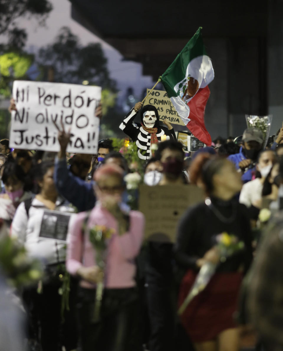 People march demanding justice for the people who died in Monday's subway collapse, in Mexico City's south side, Friday, May 7, 2021. An elevated section of Line 12 collapsed late Monday killing at least 25 people and injuring more than 70, city officials said. (AP Photo/Eduardo Verdugo)