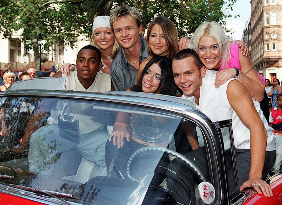 """This picture is only for editorial use in connection with the S Club 7 Proms in the Park event. Pop group S Club 7 premiered a one hour UK TV Special, """"Back to the 50's"""", at The Odeon, Leicester Square, London, prior to playing at the CBBC proms in the park.  * Band members (left-right) Bradley McIntosh , Hannah Spearritt, John Lee, Rachel Stevens, Tina Barrett, Paul Cattermole and Jo O'Meara Childrens BBC.   (Photo by Rebecca Naden - PA Images/PA Images via Getty Images)"""