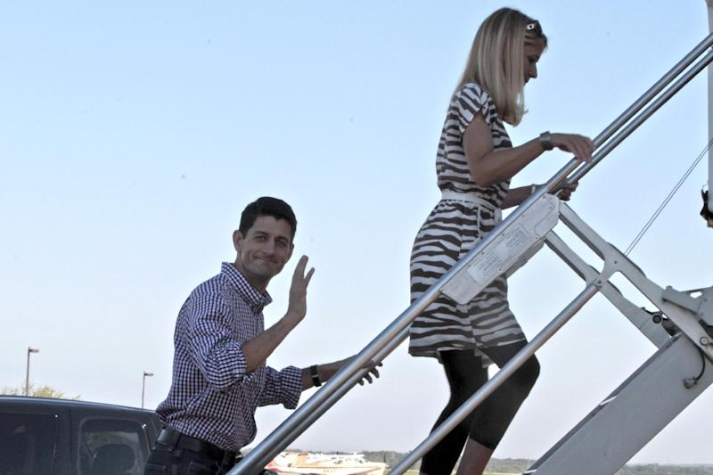 Republican vice presidential candidate, Rep. Paul Ryan, R-Wis., waves as he follows his wife Janna as they board the campaign charter  at the Southern Wisconsin regional airport, Tuesday, Aug. 28, 2012, in  Janesville, Wis.  (AP Photo/Mary Altaffer)