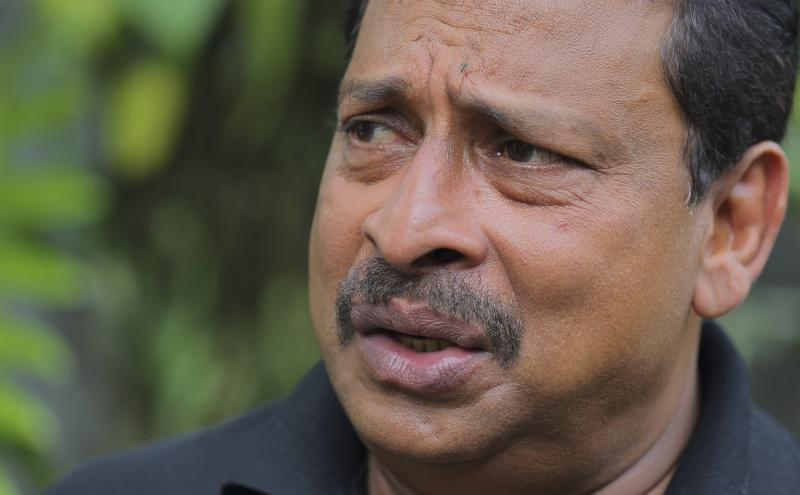 In this Sept. 12, 2016 photo, retired Sri Lanka Army Gen. Jagath Dias speaks during an interview in Colombo, Sri Lanka. In 2013, Sri Lanka sent Dias, a top military general, to investigate the alleged rape of a Haitian teenager. Dias, who has been dogged by war crimes allegations himself, never talked to the alleged victim and cleared the soldier. (AP Photo/Rishi Lekhi)