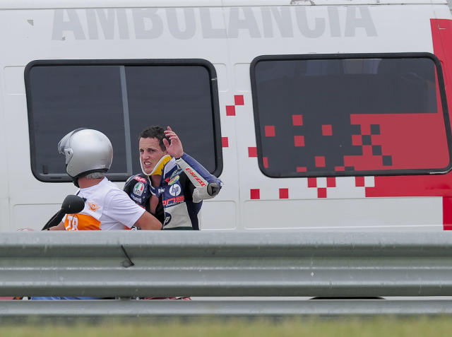 Pons 40 HP Tuenti's Spanish Pol Espargaro (R) waves after crashing during the Moto2 race of the Catalunya Moto GP Grand Prix at the Catalunya racetrack in Montmelo, near Barcelona, on June 3, 2012. Speed Master's Italian Andrea Iannone won the race ahead of Interwetten-Paddock's Swiss Thomas Luthi and Team CatalunyaCaixa Repsol 's Spanish Marc Marquez. AFP PHOTO / JOSEP LAGOJOSEP LAGO/AFP/GettyImages