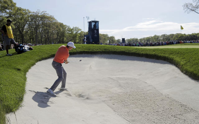 Jordan Spieth hits out of a bunker on the ninth hole during the third round of the PGA Championship golf tournament, Saturday, May 18, 2019, at Bethpage Black in Farmingdale, N.Y. (AP Photo/Julio Cortez)