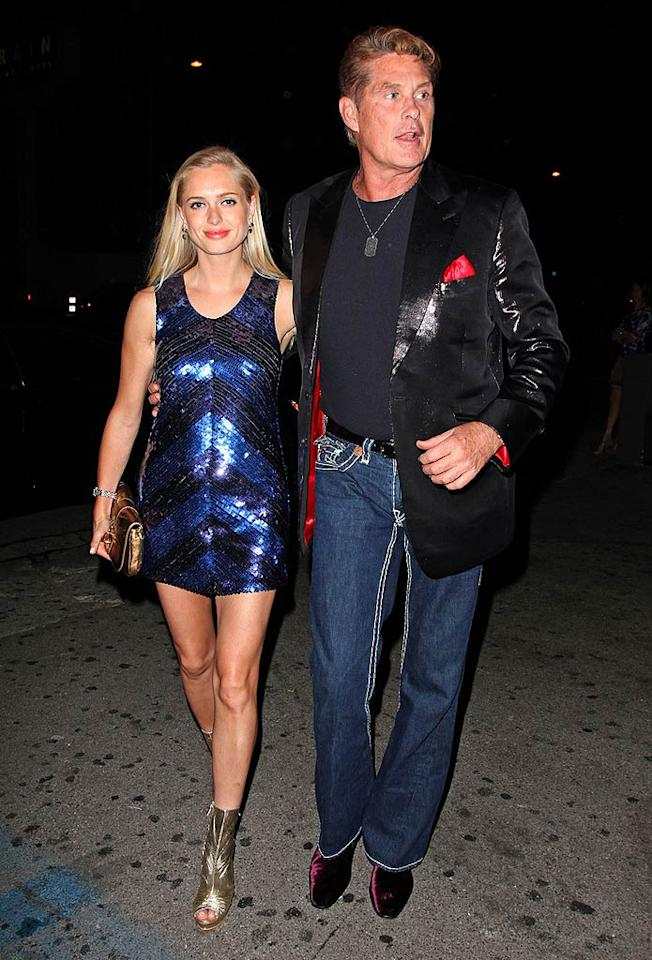 """Which part of David Hasselhoff's ensemble do you find most offensive? His poorly-dyed 'do, shiny blazer, cheesy pocket square, even cheesier jeans, velvet boots, or questionable arm candy? Anthony/<a href=""""http://www.pacificcoastnews.com/"""" target=""""new"""">PacificCoastNews.com</a> - May 7, 2010"""