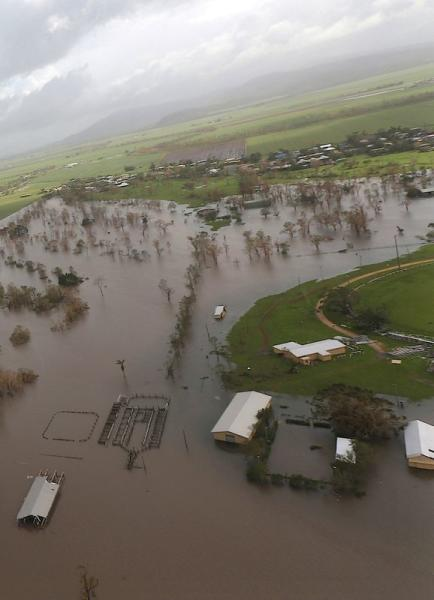 FILE PHOTO: Damaged and flooded areas can be seen from an Australian Army helicopter after Cyclone Debbie passed through the area near the town of Bowen, located south of the northern Queensland town of Townsville in Australia