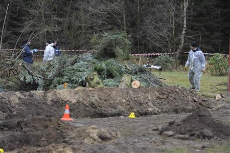 Police experts inspect the crime scene in Gimmlitztal near the town of Hartmannsdorf-Reichenau