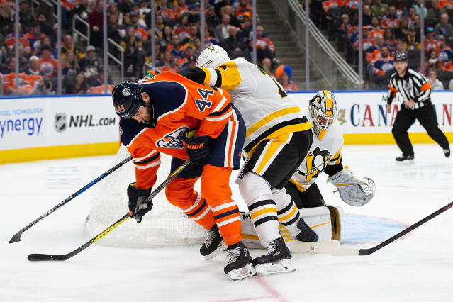 Edmonton Oilers' Zack Kassian (44) is shoved away from the net by Pittsburgh Penguins' Jack Johnson (73) as Pittsburgh Penguins goaltender Matt Murray (30) looks on during the second period of an NHL hockey game, in Edmonton, Alberta, Tuesday, Oct. 23, 2018. (Codie McLachlan/The Canadian Press via AP)