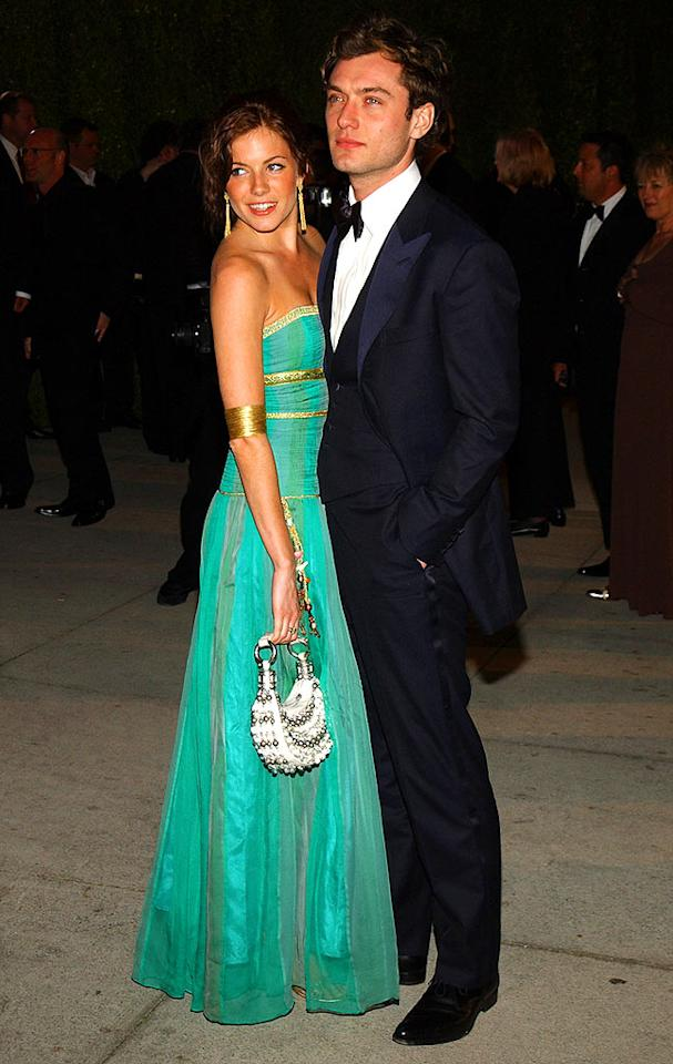 "Sienna Miller and Jude Law were engaged in '04, separated in '05 (due to an affair), reunited in '06, and officially over by '07. Talk about a whirlwind romance! Jean-Paul Aussenard/<a href=""http://www.wireimage.com"" target=""new"">WireImage.com</a> - February 9, 2004"