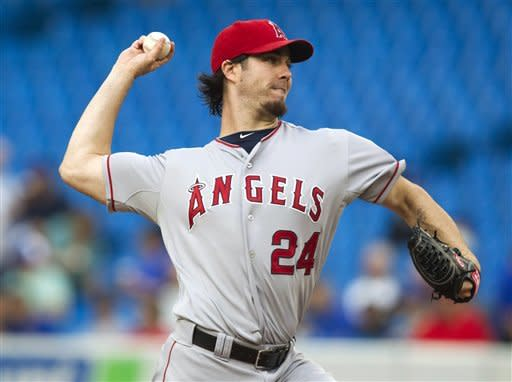 Los Angeles Angels pitcher Dan Haren throws against the Toronto Blue Jays in the first inning of a baseball game in Toronto, Thursday, June 28, 2012. (AP Photo/The Canadian Press, Fred Thornhill)