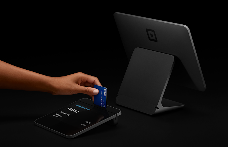 A person inserting a chip card into the Square Register.