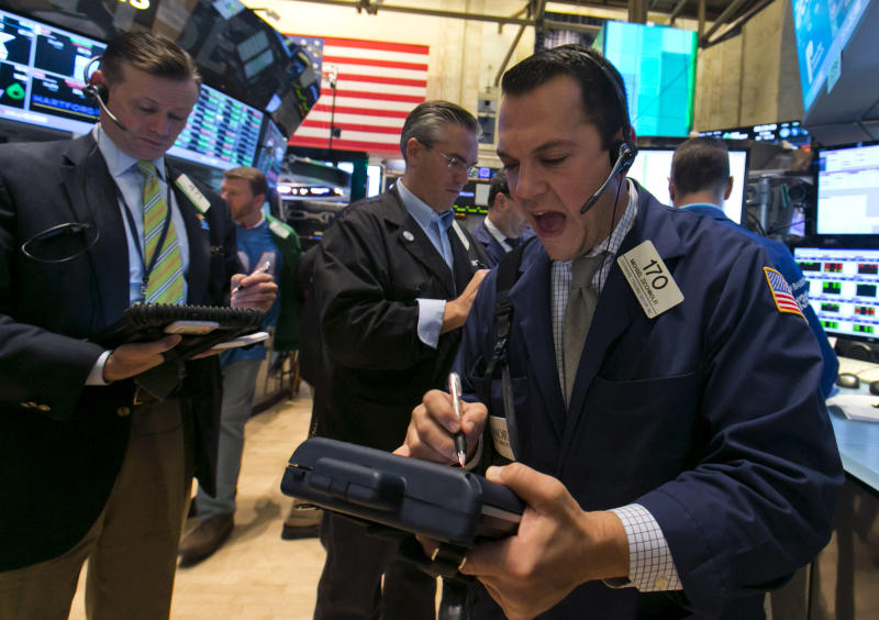 Trader Michael Zicchinolfi, right, works on the floor of the New York Stock Exchange, Friday, Oct. 25, 2013. Earnings gains from Microsoft and other big U.S. companies are pushing the stock market higher in early trading. (AP Photo/Richard Drew)