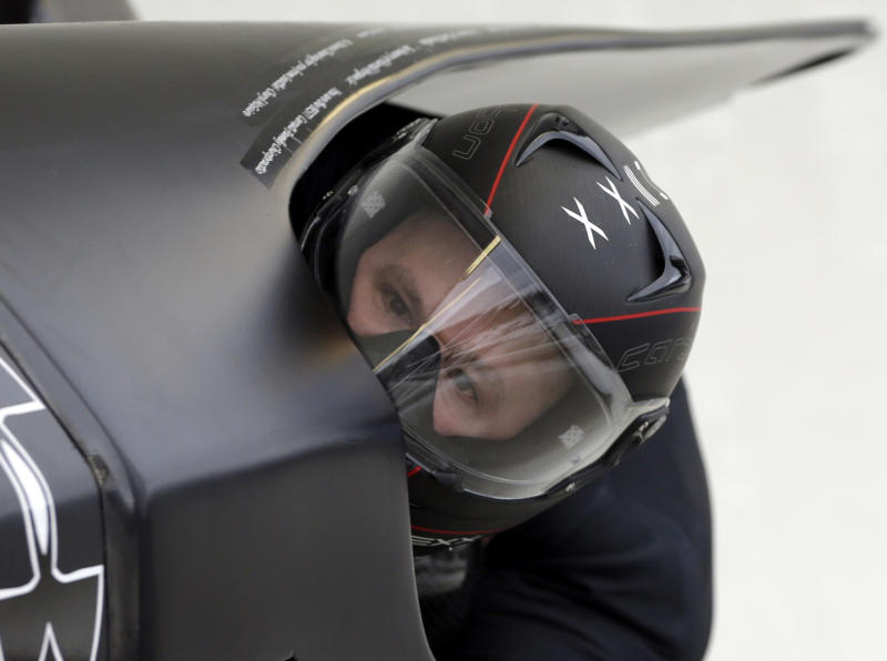 United States 1 pilot Steven Holcomb, with brakeman Steven Langton, races to the win the two-man bobsled World Cup competition on Friday, Nov. 9, 2012, in Lake Placid, N.Y. (AP Photo/Mike Groll)