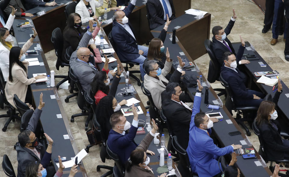 Venezuelan lawmakers vote during an extraordinary session at the National Assembly in Caracas, Venezuela, Tuesday, May 4, 2021. The National Assembly, with an overwhelming pro-government majority, appointed two recognized opponents as members of the new board of the National Electoral Council of Venezuela. (AP Photo/Ariana Cubillos)
