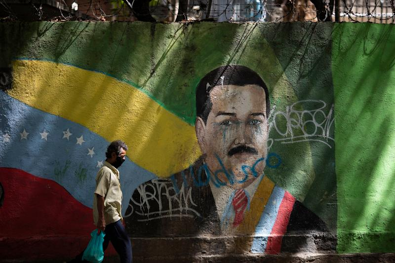 Venezuela has a relatively low number of COVID-19 cases, but human rights groups, journalists and doctors have questioned the official figures. President Nicolás Maduro has cracked down in response, strengthening his autocratic grip on the country. (Photo: AP Photo/Ariana Cubillos)
