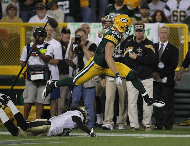 GREEN BAY, WI - SEPTEMBER 08: Jordy Nelson #87 of the Green Bay Packers leaps over Tracy Porter #22 of the New Orleans Saints during the NFL opening season game at Lambeau Field on September 8, 2011 in Green Bay, Wisconsin. The Packers defeated the Saints 42-34. (Photo by Jonathan Daniel/Getty Images)