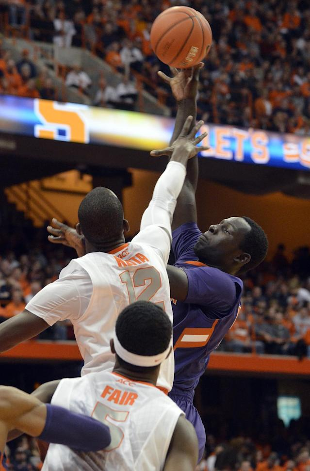 Clemson's Sidy Djitte shoots over Syracuse's Baye Moussa Keita during the first half of an NCAA college basketball game in Syracuse, N.Y., Sunday, Feb. 9, 2014. (AP Photo/Kevin Rivoli)
