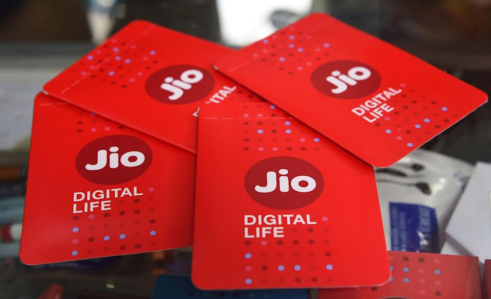 A shopkeeper displays JIO simcards at a mobile phone store in Mumbai on July 19, 2017. Indian oil-to-telecom conglomerate Reliance Industries's first-quarter consolidated profit jumped 28 percent July 20, pumped up by higher margins from its core oil refining business it said, beating analyst estimates. / AFP PHOTO / INDRANIL MUKHERJEE (Photo credit should read INDRANIL MUKHERJEE/AFP via Getty Images)