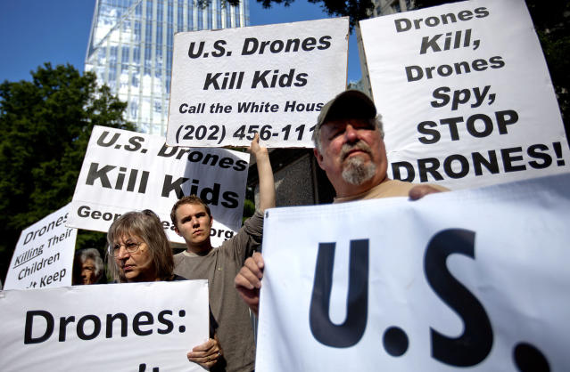 <p>Demonstrators protest against the use of drones outside the International Conference on Unmanned Aircraft Systems at the Grand Hyatt Hotel, May 28, 2013, in Atlanta. (AP Photo/David Goldman) </p>