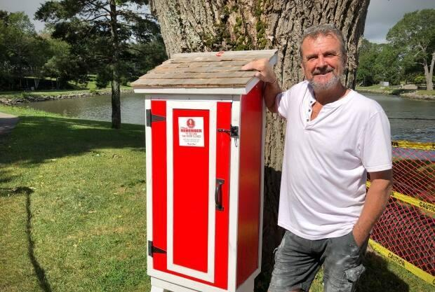 Local carpenter Alan Fagan stands by the food pantry he built and installed in Sydney's Wentworth Park. (Tom Ayers/CBC - image credit)