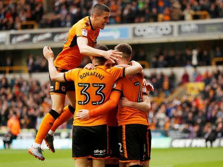 Soccer Football - Championship - Wolverhampton Wanderers vs Birmingham City - Molineux Stadium, Wolverhampton, Britain - April 15, 2018 Wolverhampton Wanderers' Diogo Jota celebrates scoring their first goal with team mates Action Images via Reuters/Andrew Boyers