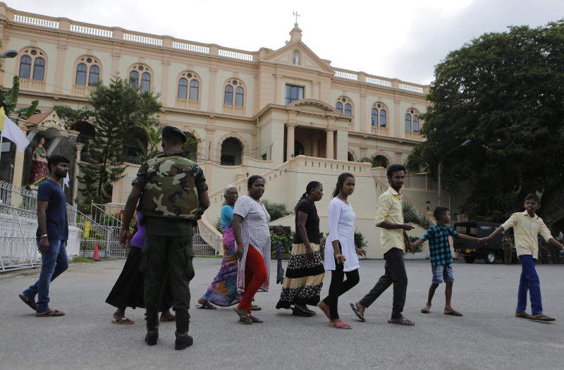 In this Sunday, May 12, 2019, photo, Sri Lankans walk past Good Shepherd convent in Colombo, Sri Lanka. Catholic officials and parents in Sri Lanka are hopeful that church-run schools will begin to reopen soon for the first time since April's devastating Easter Sunday attacks on churches and hotels. (AP Photo/Eranga Jayawardena)