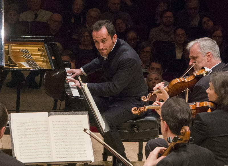 This March 5, 2019 photo released by Carnegie Hall shows pianist Igor Levit performing with the Vienna Philharmonic Orchestra at Carnegie Hall in New York. The 32-year-old pianist, winner of last year's Gilmore Artist Award, is among the most probing young artists in classical music. (Richard Termine/Carnegie Hall via AP)