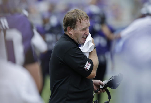 TCU head coach Gary Patterson wipes sweat from his face during the second half of an NCAA college football game against Southeastern Louisiana Saturday, Sept. 7, 2013, in Fort Worth, Texas. TCU 38-17. (AP Photo/LM Otero)