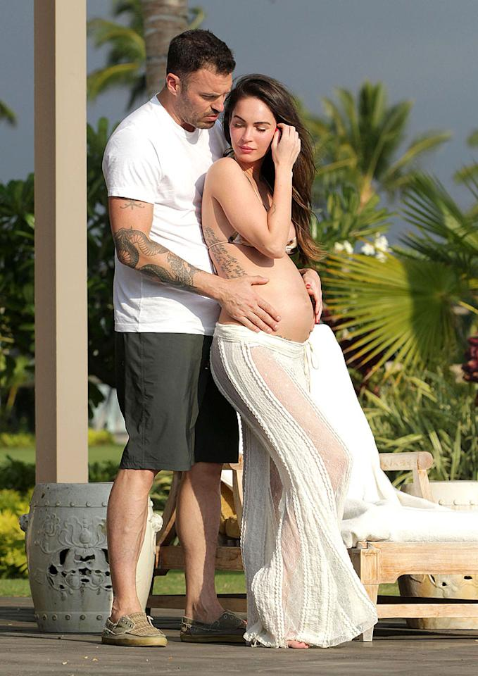[WEB OK, MUST CALL FOR PRICING] *EXCLUSIVE* Kona, HI - Actress Megan Fox and husband Brian Austin Green take their romance back to Hawaii, where they tied the knot two years ago today, celebrating their wedding anniversary and their expecting child. Megan and Brian relaxed on their private terrace where the two gazed back at each other in pure baby bliss. The expectant mom displayed her bump while wearing a leopard print bikini top with a sheer maxi sun skirt for a beautiful day on the island of Kona. AKM-GSI June 24, 2012 [WEB OK, MUST CALL FOR PRICING] To License These Photos, Please Contact : Steve Ginsburg (310) 505-8447 (323) 4239397 steve@ginsburgspalyinc.com sales@ginsburgspalyinc.com or Keith Stockwell (310) 261-8649 (323) 325-8055 keith@ginsburgspalyinc.com ginsburgspalyinc@gmail.com