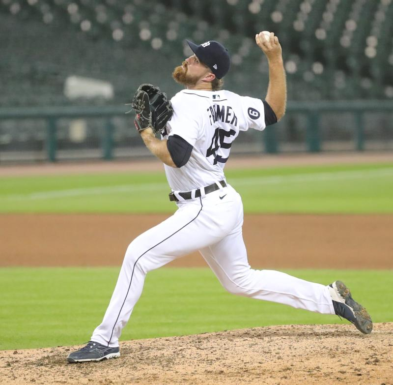Tigers pitcher Buck Farmer pitches against the Reds during the eighth inning of the Tigers' 7-2 win at Comerica Park on Friday, July 31, 2020.