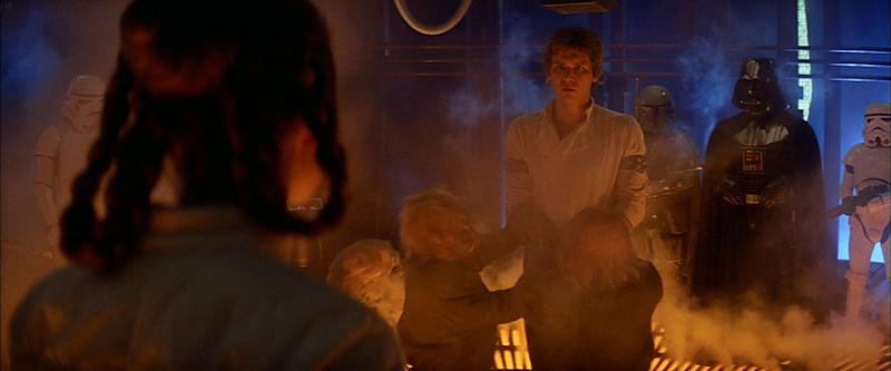 Han Solo is manhandled into position by ugnaughts. (Lucasfilm)