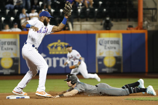 Arizona Diamondbacks pinch-runner Tim Locastro slides safely into second as New York Mets shortstop Amed Rosario (1) is late with the tag after Ketel Marte grounded out to first during the ninth inning of a baseball game Tuesday, Sept. 10, 2019, in New York. The Mets won 3-2. (AP Photo/Kathy Willens)