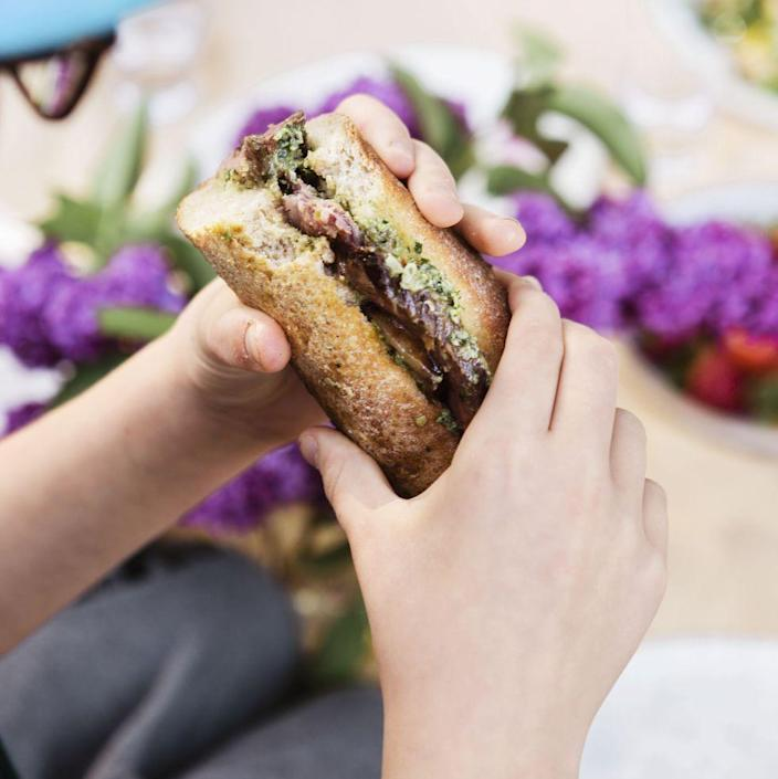 """<p>You've never seen a simpler steak sandwich recipe than this one. It only takes 15 minutes, and all you have to do is cook the steak to your likeness and whip up the delicious arugula pesto sauce. </p><p><em><a href=""""https://www.womansday.com/food-recipes/a32884143/seared-steak-sandwich-with-arugula-pesto-recipe/"""" rel=""""nofollow noopener"""" target=""""_blank"""" data-ylk=""""slk:Get the Seared Steak Sandwich with Arugula Pesto recipe."""" class=""""link rapid-noclick-resp"""">Get the Seared Steak Sandwich with Arugula Pesto recipe.</a></em></p>"""