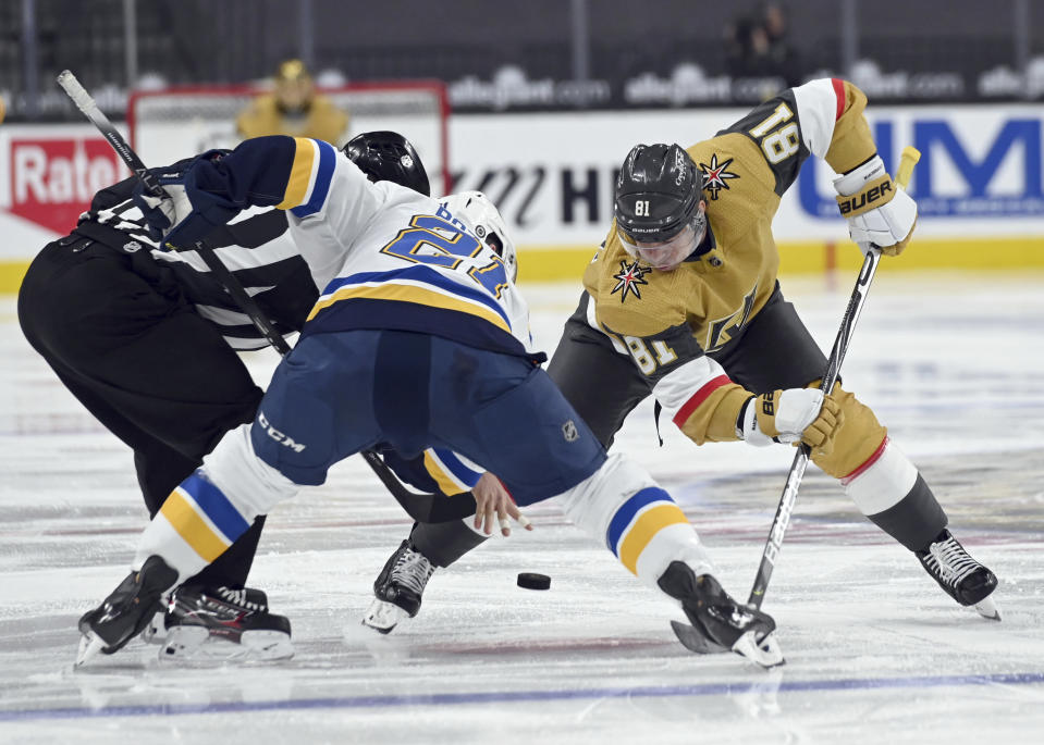 St. Louis Blues center Tyler Bozak (21) and Vegas Golden Knights center Jonathan Marchessault (81) face off during the second period of an NHL hockey game Saturday, May 8, 2021, in Las Vegas. (AP Photo/David Becker)