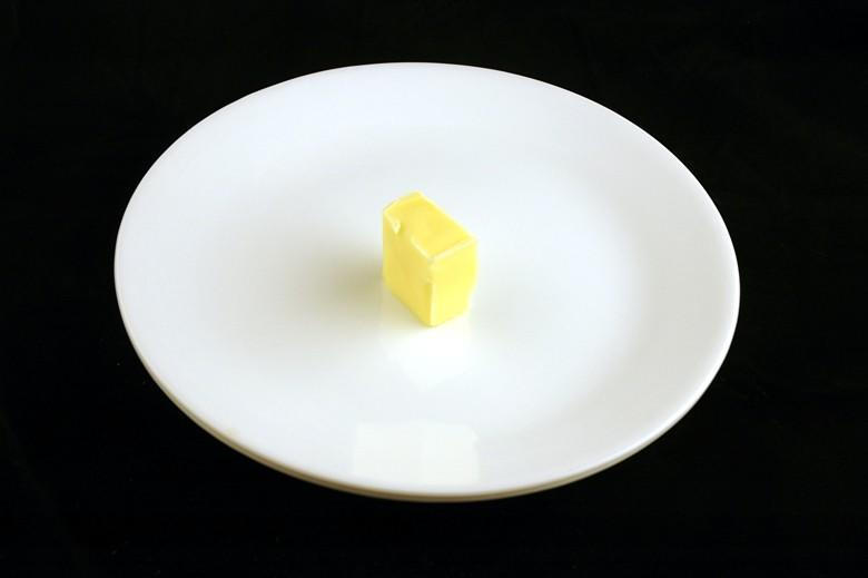 """<div class=""""caption-credit""""> Photo by: Wisegeek.com</div>200 calories of butter is a little less than 2 tablespoons. <br>"""
