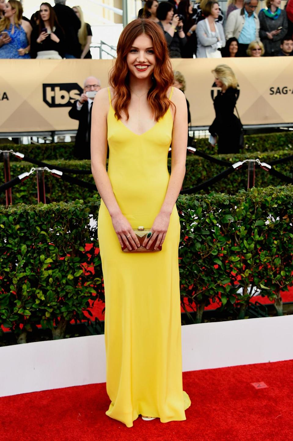 <p>Hannah Murray's red hair juxtaposed well with a bright yellow column gown. <i>Photo: Getty Images</i></p>