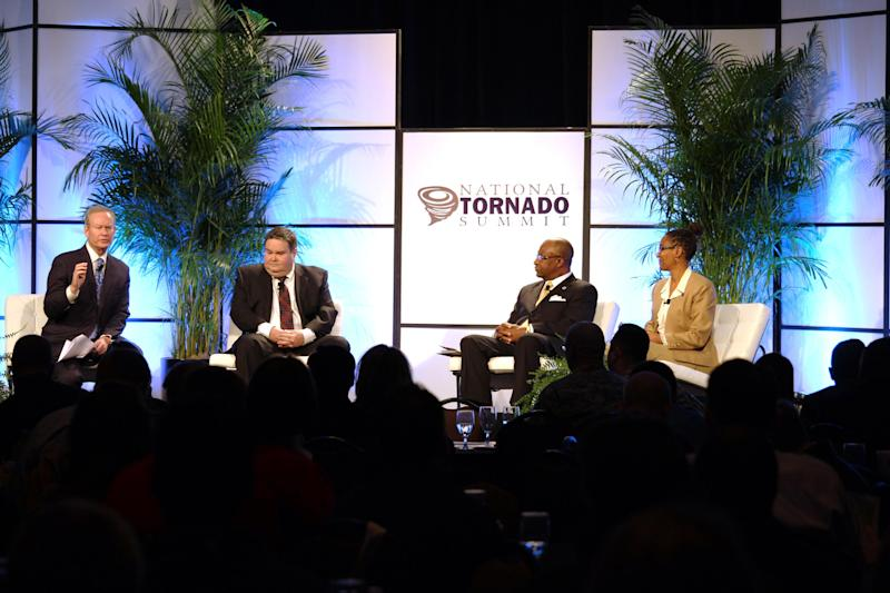 In this photo provided by the Oklahoma Insurance Department, from left, Oklahoma City Mayor Mick Cornett, Moore, Okla. Mayor Glenn Lewis, Hattiesburg, Miss Mayor Johnny DuPree and Joplin, Mo Mayor Melodee Colbert-Kean participate in a panel discussion during the National Tornado Summit in Oklahoma City on Monday, Feb. 10, 2014. About 85 percent of residents who were displaced by the large and deadly tornadoes that decimated Joplin and Moore, have rebuilt or intend to, the communities' mayors said.(AP Photo/Courtesy of Oklahoma Insurance Department)