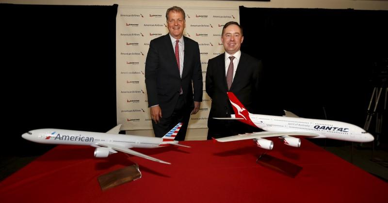 Parker, Chairman and CEO of American Airlines, stands with Qantas Managing Director and Group CEO Joyce after announcing a partnership following the IATA AGM in Miami Beach