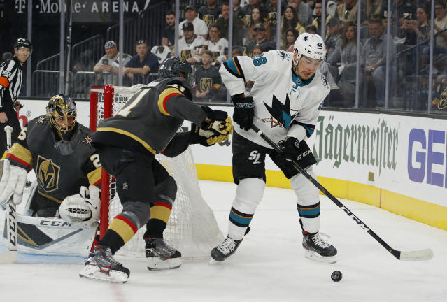 San Jose Sharks right wing Timo Meier (28) passes the puck around Vegas Golden Knights center Pierre-Edouard Bellemare (41) during the first period in Game 6 of a first-round NHL hockey playoff series Sunday, April 21, 2019, in Las Vegas. (AP Photo/John Locher)