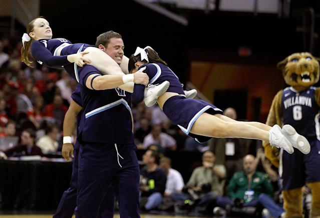 The Villanova Wildcats cheerleaders perform on the court during the game against the George Mason Patriots during the second round of the 2011 NCAA men's basketball tournament at Quicken Loans Arena on March 18, 2011 in Cleveland, Ohio. (Photo by Gregory Shamus/Getty Images)