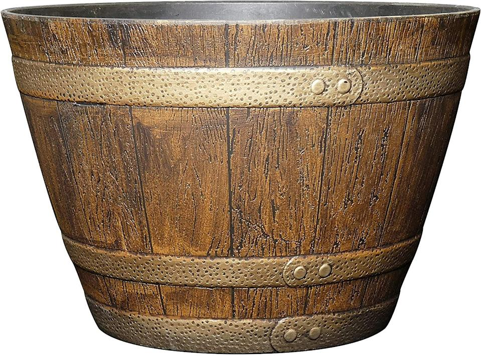 """<p>Store your larger potted plants in this rustic <span>Classic Home and Garden 72 Whiskey Barrel, 15"""", Distressed Oak</span> ($15).</p>"""