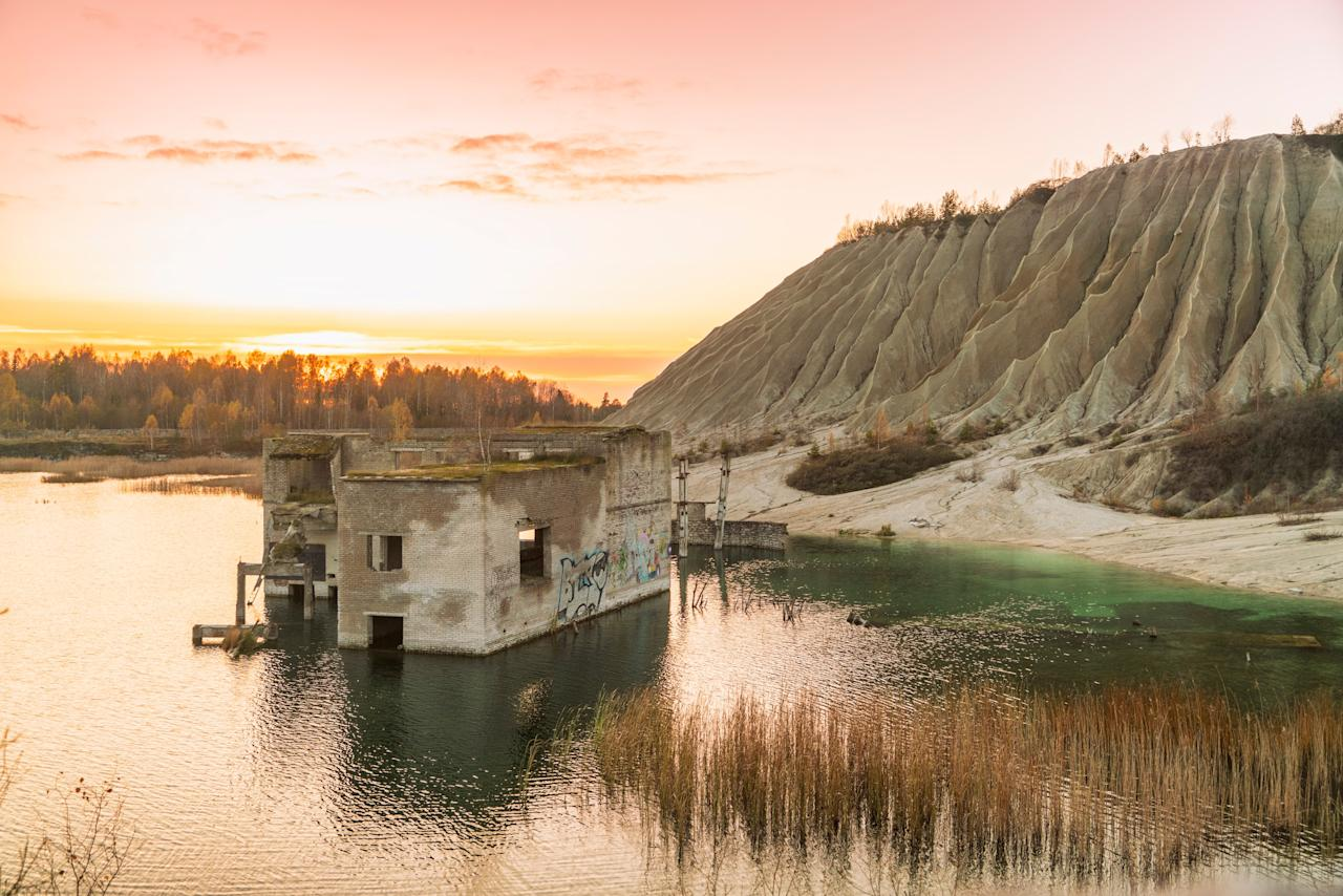 Of all the underwater sites around the world, Estonia's semi-emerged Rummu Prison might just be the creepiest. The prison was built by the Soviet Union and filled with inmates in the 1940s, where the prisoners were forced to work in the nearby limestone quarry. The jail was abandoned when Estonia gained its independence in 1991, and the lack of supervision caused the quarry to quickly fill up with water. Rummu Prison is now a popular beach, especially among scuba divers who want to explore the submerged buildings and mining equipment below the surface.