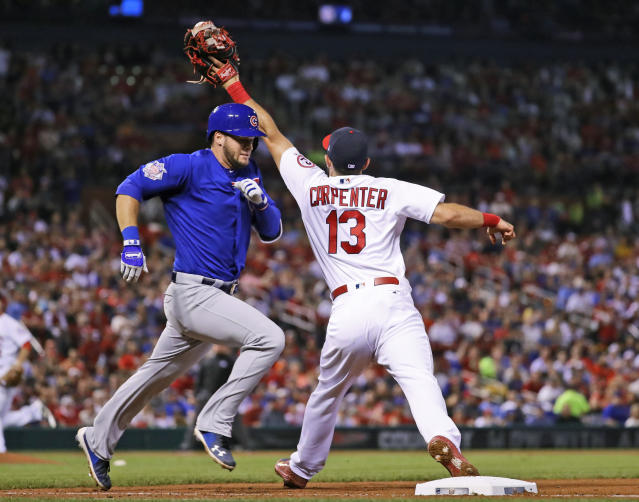 Chicago Cubs' David Bote, left, is safe as St. Louis Cardinals first baseman Matt Carpenter has to pull his foot off the bag after the throw during the fifth inning of a baseball game Sunday, July 29, 2018, in St. Louis. (AP Photo/Jeff Roberson)