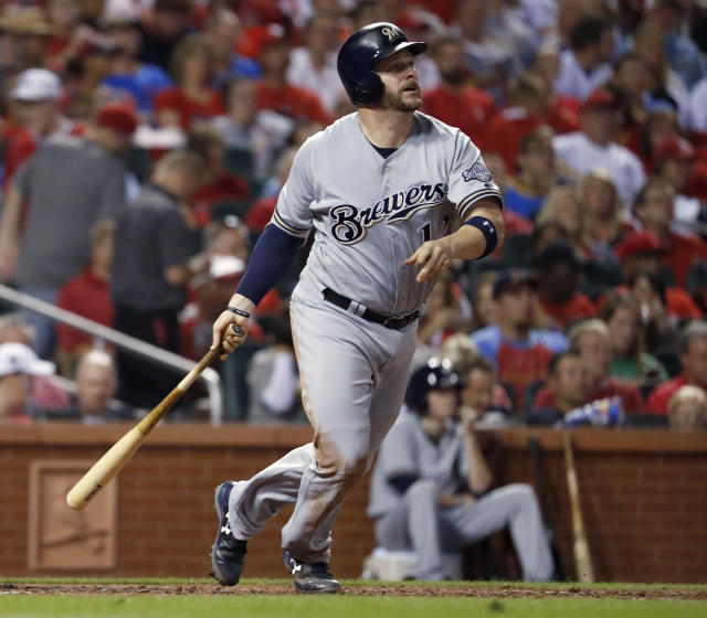 FILE - In this Sept. 29, 2017, file photo, Milwaukee Brewers' Stephen Vogt watches his solo home run during the fourth inning of a baseball game against the St. Louis Cardinals, in St. Louis. Free agent catcher Stephen Vogt is returning to the Bay Area, agreeing to a minor league contract with the San Francisco Giants. Vogt shared the news in a text message Monday, Feb. 11, 2019, when he was en route to the clubs spring training complex in Scottsdale, Arizona, for Wednesdays pitchers and catchers reporting day. (AP Photo/Jeff Roberson, File)