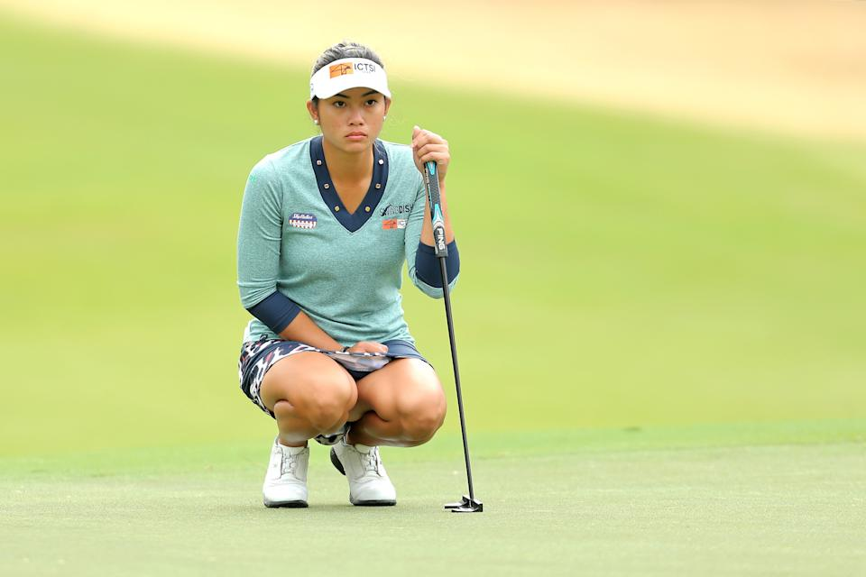 Dec 11, 2020; Houston, Texas, USA; Bianca Pagdanganan prepares to putt on the 1st green during the second round of the U.S. Women's Open golf tournament at Champions Golf Club. Mandatory Credit: Erik Williams-USA TODAY Sports