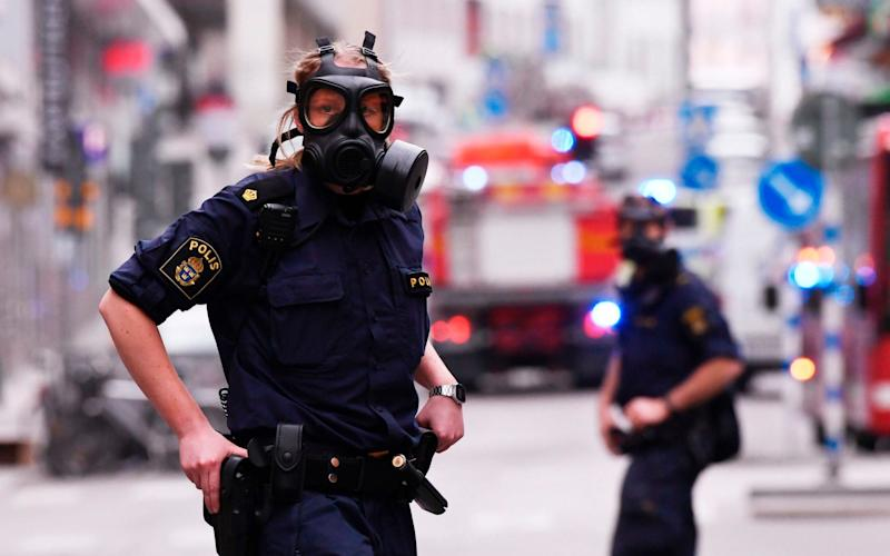 Police officers at the scene of the Stockholm attack - Credit: JONATHAN NACKSTRAND/AFP