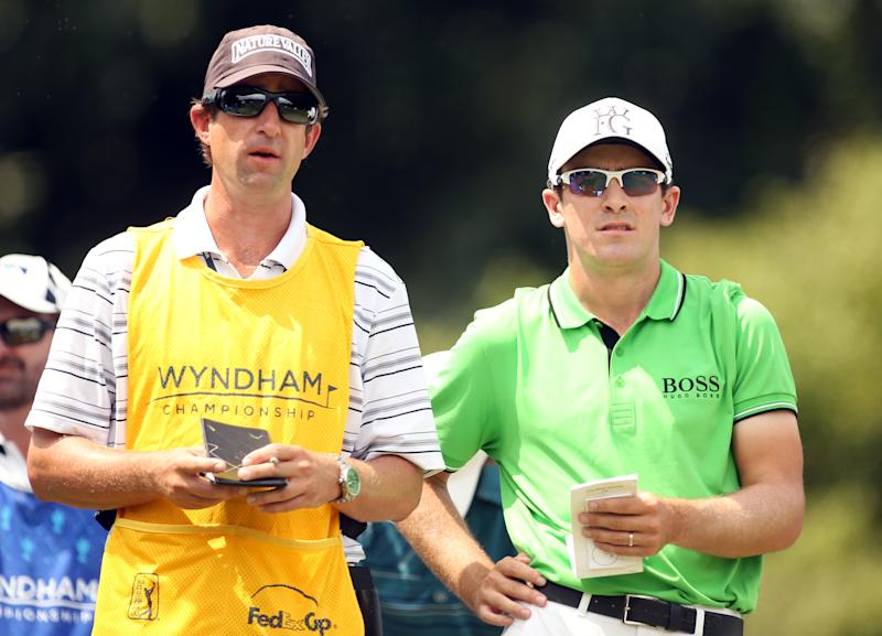 Scott Langley (R) of the US prepares to play his tee shot on the 16th hole during the second round of the Wyndham Championship, at Sedgefield Country Club in Greensboro, North Carolina, on August 15, 2014 (AFP Photo/Darren Carroll)