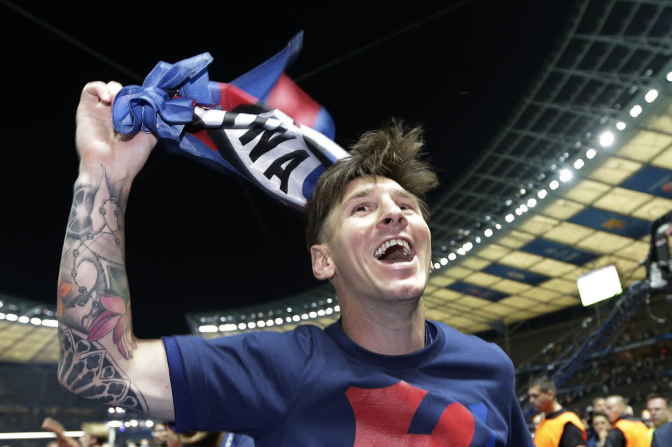 FILE - In this Saturday, June 6, 2015 file photo Barcelona's Lionel Messi celebrates after after the Champions League final soccer match between Juventus Turin and FC Barcelona at the Olympic stadium in Berlin. Barcelona won the match 3-1. Neither Lionel Messi nor Cristiano Ronaldo will be in the Champions League quarterfinals for the first time since 2005. The two greatest players of the current generation were both eliminated from the competition this week. Messi scored a goal but missed a penalty as Barcelona was eliminated by Paris Saint-Germain. Ronaldo and his Juventus teammates were ousted by Porto the night before. Ronaldo has won five Champions League titles in his career. Messi has won four. (AP Photo/Luca Bruno, File)
