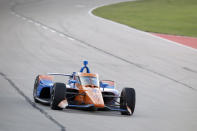 Scott Dixon heads into Turn 2 during an IndyCar auto race at Texas Motor Speedway in Fort Worth, Texas, Saturday, June 6, 2020. (AP Photo/Tony Gutierrez)